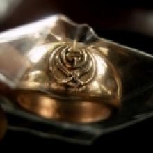 แหวนปลอกมีด ยันต์อุ ดาบไขว้ เนื้อสัมฤทธิ์ หลวงพ่ออุดม วัดพิช