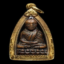 หลวงปู่ทวดเตารีดเล็ก หน้าอาปาเช่ แข้งขีด วัดช้างให้ ปี2505